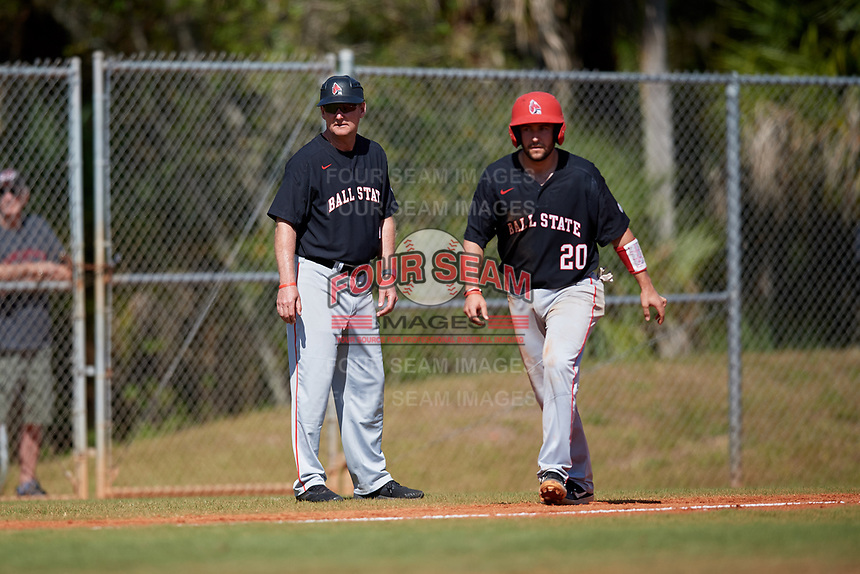 Ball State Cardinals head coach Rich Maloney (2) and Chase Sebby (20) watch the pitch during a game against the Saint Joseph's Hawks on March 9, 2019 at North Charlotte Regional Park in Port Charlotte, Florida.  Ball State defeated Saint Joseph's 7-5.  (Mike Janes/Four Seam Images)