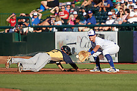 South Bend Cubs first baseman P.J. Higgins (7) stretches for a throw as Matt Thaiss (12) dives back to the bag during a game against the Burlington Bees on July 22, 2016 at Four Winds Field in South Bend, Indiana.  South Bend defeated Burlington 4-3.  (Mike Janes/Four Seam Images)