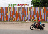 "Street scene in front of a new Karaoke Bar in Mandalay ""The new Myanmar"""