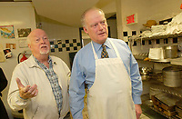 """Montreal, October 27th 2001<br /> <br /> """"Dans la rue"""" founder father Emmett Johns a.k.a. """"Pops"""" (L) gives a guided tour of the   kitchen to  AndrÈ CaillÈ (R ); president and CEO of Hydro Quebec  and honorary chairman of  it's 2001 fundraising campaign, at the organization headquarters located at 1664 Ontario East, in Montreal, CANADA, on Tuesday, November 27.<br /> <br /> CaillÈ served lunch to the young people who use the day centre and those who stop by.<br /> <br /> """"Dans la rue"""", an organization founded in 1988 by father Emmett Johns a.k.a. """"Pops"""" is well known for the services offered by the Roulotte, an emergency shelter and day centre. . This year's goal is to raise $2.5 million to help Montreal's 5,000 young homeless people<br /> throughout the year.<br /> <br /> <br /> Photo by Sevy-IMAGES DISTRIBUTION <br /> <br /> NOTE :  D-1 H original JPEG, saved as Adobe 198 RGB"""