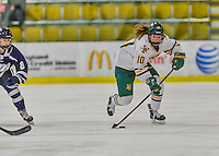 14 February 2015: University of Vermont Catamount Forward Mackenzie MacNeil, a Freshman from Richmond Hill, Ontario, leads a first period rush against the University of New Hampshire Wildcats at Gutterson Fieldhouse in Burlington, Vermont. The Lady Catamounts rallied from a 3-1 deficit to earn a 3-3 tie in the final home game of their NCAA Hockey East season. Mandatory Credit: Ed Wolfstein Photo *** RAW (NEF) Image File Available ***