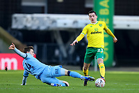 9th January 2021; Carrow Road, Norwich, Norfolk, England, English FA Cup Football, Norwich versus Coventry City; Ben Sheaf of Coventry City challenges Kenny McLean of Norwich City