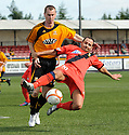 East Fife's Paul McManus goes down in the penalty box under a challenge from Alloa's Stephen Simmons but ref Frank McDermott waves play on.