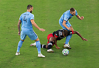 WASHINGTON, DC - SEPTEMBER 06: Ola Kamara #9 of D.C. United is fouled by Alexander Callens #6 of New York City FC during a game between New York City FC and D.C. United at Audi Field on September 06, 2020 in Washington, DC.