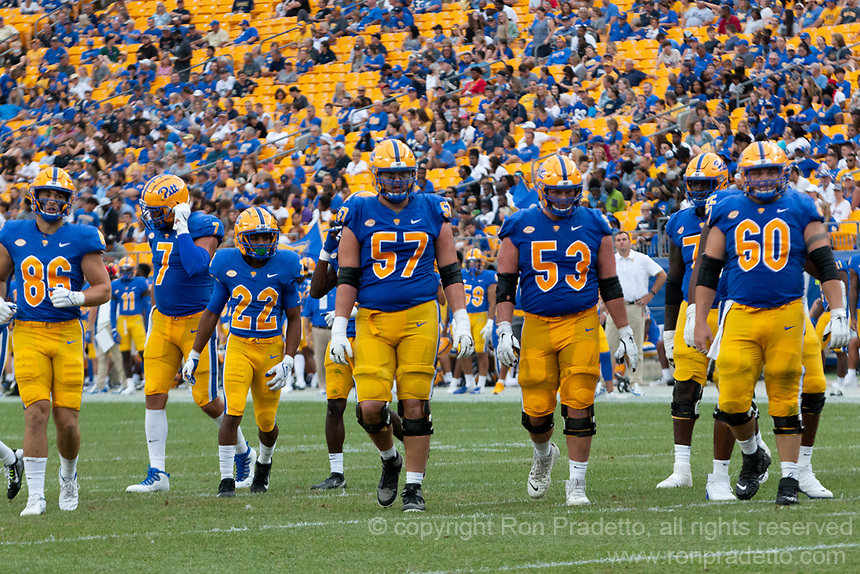 The Pitt football team offense takes the field. Pictured are tight ends Gavin Bartholomew (86) and Lucas Krull (7), running back Vincent Davis (22), and offensive linemen Gabe Houy (57), Jake Kradel (53) and Owen Drexel (60).  The Pitt Panthers defeated the UMass Minutemen 51-7 on September 4, 2021 at Heinz Field, Pittsburgh, PA.