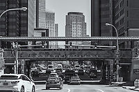 Midday traffic passes under the welcome sign on Metro-North Railroad tracks entering the downtown area of White Plains, New York.