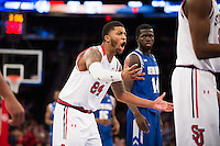 NEW YORK, NY - Sunday December 21, 2015: Ron Mvouika (#24) of St. John's argues a call against Seton Hall as the two teams square off in regular season play at Madison Square Garden.