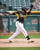 Kaleb Cowart (22) of the Salt Lake Bees follows through on his swing against the El Paso Chihuahuas in Pacific Coast League action at Smith's Ballpark on April 30, 2017 in Salt Lake City, Utah. El Paso defeated Salt Lake 12-3. This was Game 2 of a double-header originally scheduled on April 28, 2017. (Stephen Smith/Four Seam Images)