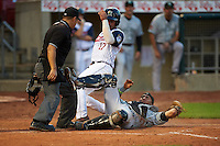 Umpire Arturo Gonzalez looks to Kane County Cougars catcher Michael Perez (9) after diving to tag Rafael P Valera (17) sliding into home during a game against the Cedar Rapids Kernels on August 18, 2015 at Perfect Game Field in Cedar Rapids, Iowa.  Kane County defeated Cedar Rapids 1-0.  (Mike Janes/Four Seam Images)