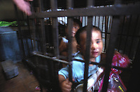 Qi Qi, 3, male (right)  and Gwen Gwen, 5, are kept in a cage in a village house belonging to their uncle. The children's parents are both in prison and the uncle is too poor to afford child care for the children and are afraid they may be stolen and are afraid they may be stolen a common problem in China...PHOTO BY SINOPIX