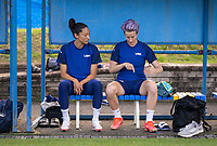 KASHIMA, JAPAN - AUGUST 1: Christen Press #11 and Megan Rapinoe #15 of the USWNT talk before  a training session at the practice field on August 1, 2021 in Kashima, Japan.