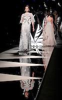 Modelle presentano le creazioni della collezione Autunno-Inverno 2013 di Mireille Dagher durante la rassegna Altaroma a Roma, 6 luglio 2013.<br /> Models wear creations of the Mireille Dagher house's Fall-Winter 2013 collection during the Altaroma fashion week in Rome, 6 July 2013.<br /> UPDATE IMAGES PRESS/Isabella Bonotto