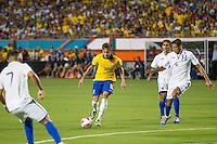 Miami, FL - Saturday, Nov 16, 2013: Brazil vs Honduras during an international friendly at Miami's Sun Life Stadium. Brazilian Neymar is chased by Honduras defenders.