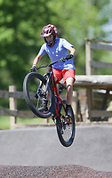 Braxton Collins, 13, of Conway rides off of a ramp, Friday, April 30, 2021 at the Railyard bike park in Rogers. Check out nwaonline.com/210501Daily/ for today's photo gallery. <br /> (NWA Democrat-Gazette/Charlie Kaijo)