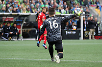 SEATTLE, WA - NOVEMBER 10: Quentin Westberg #16 of Toronto FC throws the ball towards Nick DeLeon #18 during a game between Toronto FC and Seattle Sounders FC at CenturyLink Field on November 10, 2019 in Seattle, Washington.