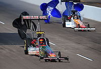 Feb. 18, 2012; Chandler, AZ, USA; NHRA top fuel dragster driver Terry McMillen (left) and Clay Millican during qualifying for the Arizona Nationals at Firebird International Raceway. Mandatory Credit: Mark J. Rebilas-