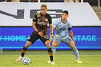 KANSAS CITY, UNITED STATES - AUGUST 25: Darwin Ceren #24 of Houston Dynamo holds off Alan Pulido #9 of Sporting Kansas City  a game between Houston Dynamo and Sporting Kansas City at Children's Mercy Park on August 25, 2020 in Kansas City, Kansas.