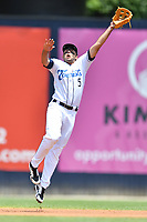 Asheville Tourists shortstop Coco Montes (5) leaps for the ball during a game against the Lakewood BlueClaws at McCormick Field on June 16, 2019 in Asheville, North Carolina. The BlueClaws defeated the Tourists 6-5. (Tony Farlow/Four Seam Images)