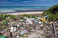 marine debris, plastic trash on the beach, washed ashore, Turneffe Atoll, Belize Barrier Reef, Belize, Caribbean Sea, Atlantic Ocean