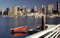 AJ3649, Vancouver, skyline, British Columbia, Canada, Skyline of Vancouver from across the water at Vancouver Rowing Club in the province of British Columbia. Red rowboat in foreground.