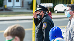 WATERTOWN, CT-123020JS07- Watertown Police Chief John Gavallas salutes as vehicles of supporters pass by during a send-off parade and ceremony in his honor of Wednesday at the Watertown Police Department. Chief Gavallas has served for 51 years. <br /> Jim Shannon Republican-American