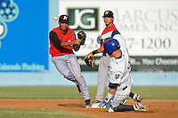 Kannapolis Intimidators shortstop Marcus Semien #6 makes the turn on a double play over a hard sliding Brett Tanos during game against the Asheville Tourists at McCormick Field on July 20, 2011 in Asheville, North Carolina. Asheville won the game 5-4.   (Tony Farlow/Four Seam Images)