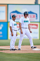 Lynchburg Hillcats manager Rouglas Odor (24) and Anthony Miller (40) during the first game of a doubleheader against the Potomac Nationals on June 9, 2018 at Calvin Falwell Field in Lynchburg, Virginia.  Lynchburg defeated Potomac 5-3.  (Mike Janes/Four Seam Images)