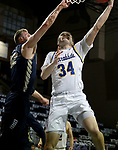 SIOUX FALLS, SD - MARCH 8: Alex Arians #34 of the South Dakota State Jackrabbits lays the ball up against Francis Lacis #22 of the Oral Roberts Golden Eagles during the Summit League Basketball Tournament at the Sanford Pentagon in Sioux Falls, SD. (Photo by Dave Eggen/Inertia)