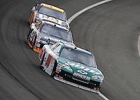 Feb 22, 2009; Fontana, CA, USA; NASCAR Sprint Cup Series driver Dale Earnhardt Jr (88) leads Reed Sorenson (43) and Jeff Burton during the Auto Club 500 at Auto Club Speedway. Mandatory Credit: Mark J. Rebilas-