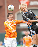 San Francisco, California - Saturday March 17, 2012: Bobby Boswell and Steven Lenhart fight for the ball during the MLS match at AT&T Park.  Houston Dynamo defeated San Jose Earthquakes  1-0