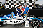 "Winner Takuma Sato, Rahal Letterman Lanigan Racing Honda, podium, with Jonathan ""Rusty"" Tucker, Beth Tucker, and Thomas the fastest kid in Leeds, Alabama"
