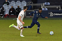 KANSAS CITY, KS - OCTOBER 24: #4 Danny Wilson of the Colorado Rapids chases after #12 Gerso Fernandes of Sporting Kansas City as he sprints toward goal during a game between Colorado Rapids and Sporting Kansas City at Children's Mercy Park on October 24, 2020 in Kansas City, Kansas.