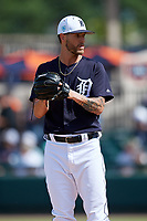 Detroit Tigers relief pitcher Shane Greene (61) gets ready to deliver a pitch during a Grapefruit League Spring Training game against the Atlanta Braves on March 2, 2019 at Publix Field at Joker Marchant Stadium in Lakeland, Florida.  Tigers defeated the Braves 7-4.  (Mike Janes/Four Seam Images)