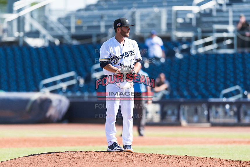 Peoria Javelinas starting pitcher Bubba Derby (12), of the Milwaukee Brewers organization, gets ready to deliver a pitch during an Arizona Fall League game against the Glendale Desert Dogs at Peoria Sports Complex on October 22, 2018 in Peoria, Arizona. Glendale defeated Peoria 6-2. (Zachary Lucy/Four Seam Images)
