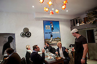 Chef Giorgio Grilenzoni talks with diners at the restaurant 'Chat Noir, Chat Blanc', Nice, France, 10 April 2012