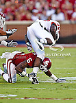 Oklahoma Sooners defensive back Demontre Hurst (6) and Ball State Cardinals running back Jahwan Edwards (38) in action during the game between the Ball State Cardinals  and the Oklahoma Sooners at the Oklahoma Memorial Stadium in Norman, Oklahoma. OU defeats Ball State 62 to 6.