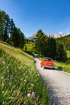Italy, South Tyrol (Trentino - Alto Adige), Dolomites, Val Gardena: Oldtimer Fiat Cinquecento on rural road above Selva di Val Gardena | Italien, Suedtirol (Trentino - Alto Adige), Dolomiten, Groednertal: Oldtimer Fiat Cinquecento auf einsamer Landstrasse oberhalb von Wolkenstein in Groeden