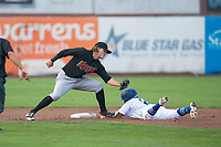 Great Falls Voyagers shortstop Travis Moniot (16) tries to tag Kenneth Betancourt (9) as he slides into second base on a stolen base attempt during a Pioneer League against the Ogden Raptors at Lindquist Field on August 23, 2018 in Ogden, Utah. The Ogden Raptors defeated the Great Falls Voyagers by a score of 8-7. (Zachary Lucy/Four Seam Images)
