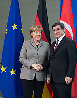 German Chancellor Angela Merkel (L) and Turkish Prime Minister Ahmet Davutoglu (R) shake hands after a press conference at the Federal Chancellery in Berlin, Germany, 12 January 2015. Questions of bilateral and European relations, as well as economic and international questions were the main theme of talks over lunch. Photo: BERND VON JUTRCZENKA/dpa