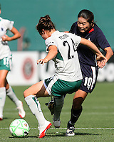 Homare Sawa #10 of the Washington Freedom slips the ball past Kendell Fletcher #24 of St. Louis Athletica during a WPS match at RFK Stadium on July 18 2009, in Washington D.C. Freedom won the match 1-0.