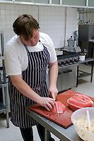 Head Chef preparing fruit salads, State Secondary Roman Catholic school.