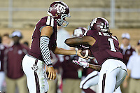 Texas A&M quarterback Kenny Hill (7) hands off to running back Brandon Williams (1) during first half of an NCAA football game, Saturday, October 11, 2014 in College Station, Tex. Ole Miss leads Texas A&M 21-0 at the halftime. (Mo Khursheed/TFV Media via AP Images)