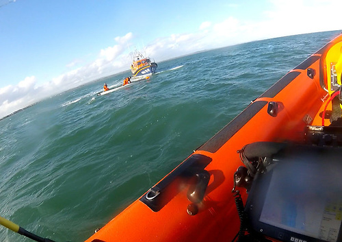 Skerries RNLI's inshore lifeboat and Clogherhead RNLI's all-weather lifeboat approach the sailing dinghy in distress off Laytown
