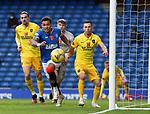 25.10.2020 Rangers v Livingston: Rangers captain James Tavernier leads the chase to close down the ball