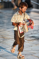 A kid with accordion in the street of Athens, Greece