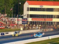 May 4, 2018; Commerce, GA, USA; NHRA funny car driver Jonnie Lindberg (left) races alongside Bob Tasca III during qualifying for the Southern Nationals at Atlanta Dragway. Mandatory Credit: Mark J. Rebilas-USA TODAY Sports