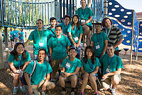 """Members pose for a group photo before working in the Hawthorne neighborhood during """"Circle the City with Service,"""" the Kiwanis Circle K International's 2015 Large Scale Service Project, on Wednesday, June 24, 2015, in Indianapolis. (Photo by James Brosher)"""