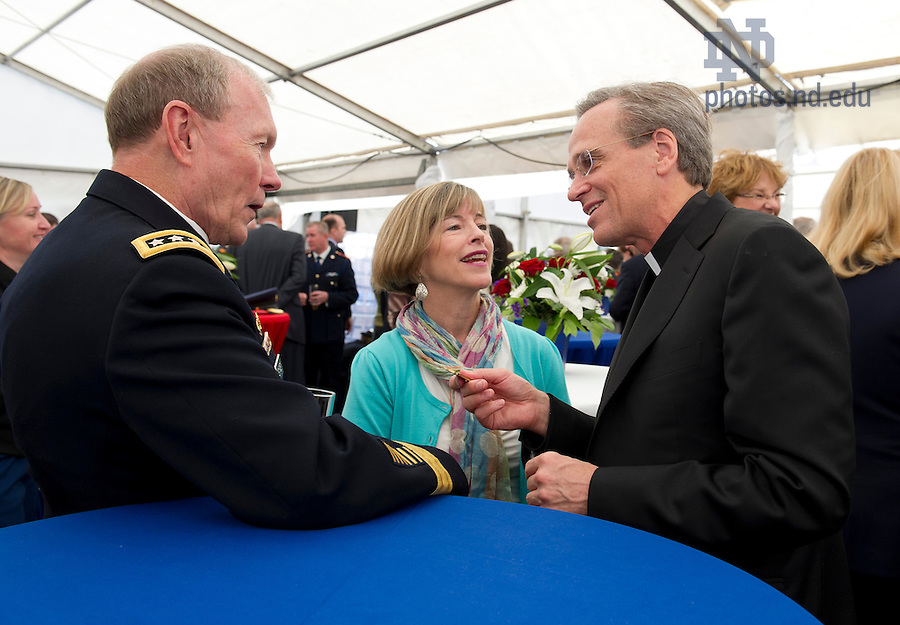 September 1, 2012; Rev. John I. Jenkins, C.S.C., chats with General Martin E. Dempsey, Chairman of the Joint Chiefs of Staff and wife Deanie, during a reception aboard the Ft. McHenry Ship prior to the Emerald Isle Classic against Navy in Dublin, Ireland. Photo by Barbara Johnston/University of Notre Dame