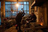 A Roma blacksmith worker in the Terzi Mahalla in the town of Prizren