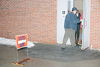 People arrive to vote in the New Hampshire Presidential Primary at Fair Grounds Junior High School in Nashua, New Hampshire, on Tue., Feb. 11, 2020.